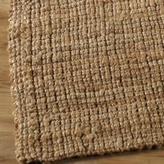 Jute Natural Boucle Rug on hardwood floor w/ leather couches around it... sigh...