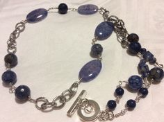 Lapis lazuli, sodalite, agate, sterling silver wire and plated metal necklace.