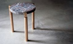 A new table design from Michaël Verheyden - produced in wood, brass and marble