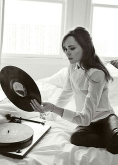 Leather pants, white button down and halfup hair. (+ records are pretty cool.)