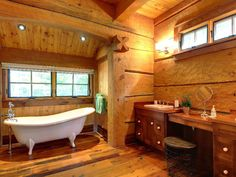 A bathroom in one of the many log homes that Matt Davidson and his crews have designed and built. Hand-worked log surfaces, carved details and curved shapes set Davidson's work apart.