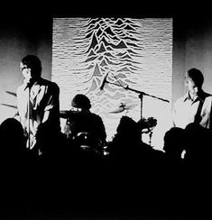 Joy Division(Ian,Steve,Peter with Artwork of Unknown Pleasures,probably 1979)