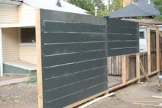Fence made of HardiePlank Lap Siding. Outdoor Walls, Outdoor Spaces, Outdoor Decor, Landscaping Supplies, Backyard Landscaping, Fence Design, Garden Design, Side Walkway, Landscape Drainage