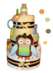 Owl Theme Diaper Cake  http://www.storkbabygiftbaskets.com/baby-owl-diaper-cake.html