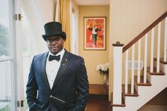 Vintage groom outfit idea - dark navy tuxedo with black top hat, black bow tie and gold pocket watch {OLLI STUDIO}
