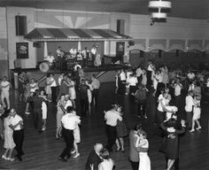 Dozens of people dance at the Avalon ballroom in this undated photo. Copeland Avenue, La Crosse, WI. (5,670 square foot dance floor, star-like ceiling; lights shining through a screen creating a twinkling effect.)