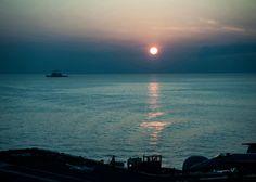 Navy ship at sunset