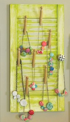 Shutter Necklace Holder: Johnny In A Dress Wooden clothespins and an old shutter marry to make this great jewelry holder. It works for necklaces, hoop earrings, bangles, bracelets and even rings. I think it would be brilliant at a craft fair.