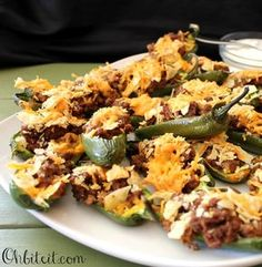 Taco Stuffed Jalapeno Peppers: 15 peppers 1lb ground beef, 1 taco seasoning pkt, 2cups shredded cheddar, 2 cups crushed tort chips. Brown beef with seasoning, cool slightly, add 1 1/2 cup cheese, fill and add chips on top then remaining cheese. Bake 350 for 25 mins. Serve with hot sauce and sour cream