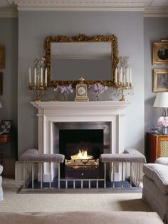 The pale blue drawing room is traditionally furnished with a club fender around the fireplace Fireplace Seating, Fireplace Hearth, Modern Fireplace, Fireplace Design, Fireplace Guard, Fireplace Facade, Mantle, Georgian Interiors, Georgian Homes