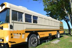 Painting a converted school bus can be done on a DIY budget and look great.