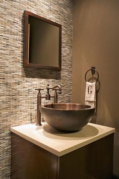 I think it's interesting (and probably more economical) to have the tiles on one wall like this. Hmmm...