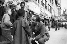125th st. Harlem, Congressman Rangel having a chat with kids. 1960's