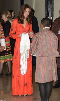 Lady in red: The Duchess is presented with a silk scarf by Ugyen Michael Wangchukat at the...