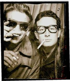 Buddy Holly in a photo booth with Waylon Jennings in Central Station, New York City in 1959.