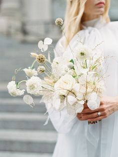 This monochrome bouquet by Amanda of Studio Imbue is proof that a wedding-white bouquet can absolutely be modern. The secret? Using futuristic floral varieties, like silver lunaria and scabiosa.