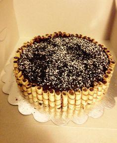 Chocolate cake with hazelnut dark chocolate ganache, dark chocolate crème de pirouline border and cookies & cream crunch topping