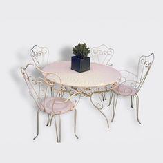 Table de jardin en fer forgé et ses 4 fauteuils