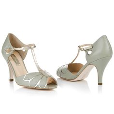 Gorgeous statement t-bar sandal in buttery soft leather with fine metallic detailing. The petal design looks stunning worn alone, or add a touch of sparkle with the Deco Oval or Teardrop clips. Available in ivory, pale mint and pale peach.