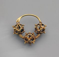 Earring. Date: Late 12th - first half of the 13th century. Archaeological site: Kiev, the Yesikorsky Estate. Material: gold.