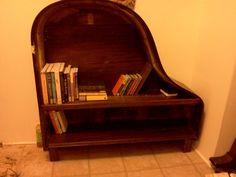 A piano bookshelf, yeah I totally saw that coming