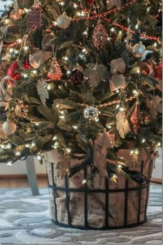 Great alternative to a tree skirt! Use a metal basket with burlap liner to hide Christmas tree base. Balsam Fir Christmas Tree, Christmas Tree Base, All Things Christmas, Christmas Home, White Christmas, Christmas Holidays, Christmas Wreaths, Christmas Crafts, Christmas Decorations