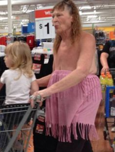 Woman with saggy boobs wearing skirt at her waist at walmart. Fashion Bad, Should not wear, NOT FASHION, sexy, Fashion Disappoint