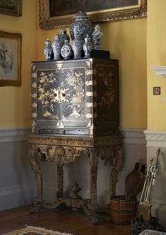 This furniture is laquered wood which is classic Chinoiserie period. It also shows the blue and white porcelain vases typical of this time.