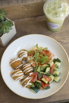 Our falafel bowl with homemade hummus and an Israeli salad, with an iced Matcha latte on the side
