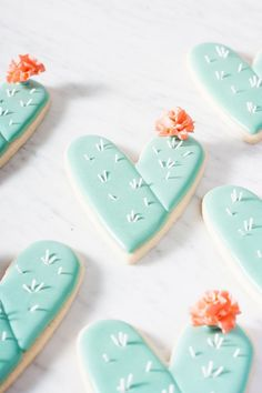 Use a heart cookie cutter to make cute cactus heart cookies! Learn how to embellish your cactus cookies with gum paste spines and sugar flowers.