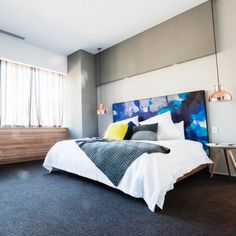 The Block Glasshouse – Master Bedroom with art printed headboard in shades of blue and grey with copper accents and timber panel feature wall
