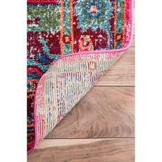 Soft and plush, the pile on this contemporary area rug is made from 100% polypropylene to prevent shedding, and will tie together any fashionable space. Add a sense of vintage flair to any room with t