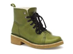 Green boots = Necessary footwear.