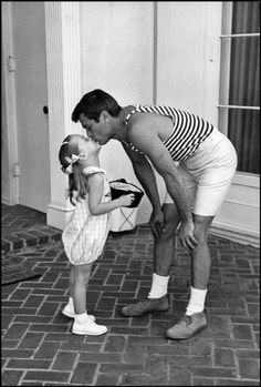 Actor Tony Curtis at his home in Beverly Hills with his daughter Jamie Lee Curtis, 1960.