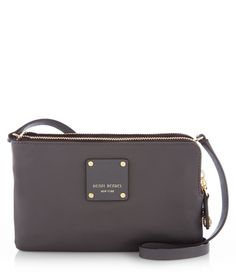 A luxury handbag adorned with chic Saffiano leather trim and custom Henri Bendel hardware, the Jetsetter Mini Crossbody is the perfect travel companion this season.