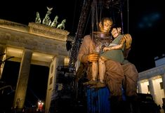 The Big Giant and the Little Giantess, newly reunited, sleep in each others' arms in front of the Brandenburg Gate in Berlin, Saturday, Oct. 3, 2009.