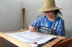 Woman embroidering cloth #GuiadeIsora #Tenerife during the 'Day of Traditions'