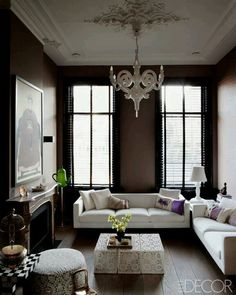 Beautiful mix of old and new in a living room. Lovely antiques,  modern sofa,  fantastic old fireplace.