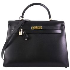 View this item and discover similar for sale at - This Hermes Kelly Handbag Noir Box Calf with Gold Hardware crafted in Noir black Box Calf leather, features single rolled top handle, protective base Hermes Handbags, Fashion Handbags, A Perfect Murder, Black Box, Leather Interior, Luxury Bags, Hermes Kelly, Gold Hardware, Calf Leather