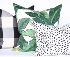 Tropical banana leaf pillow with black and white counter parts. All this goodness available at www.tonicliving.com