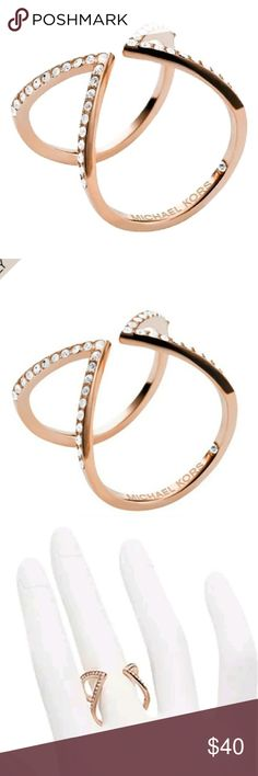 Michael Kors motifs Arrow ring rose gold Michael Kors rose gold color motifs Arrow ring adjustable size . Add this to a bundle for a private discount:) with my other items Michael Kors Jewelry Rings