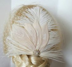 Check out this item in my Etsy shop https://www.etsy.com/listing/484083262/champagne-ivory-feather-fascinator