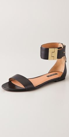 These leather flat sandals feature a buckle detail at the buttoned ankle strap. Exposed back zip. Padded footbed. Non-slip rubber patch at leather sole.   Leather: Calfskin.   This item cannot be gift-boxed.