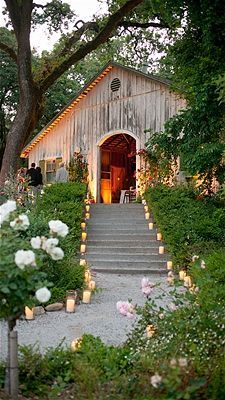 Whimsical candle walkway |  A candlelit walkway -  Todd Fiscus, founder of Todd Events, lit the way to a reception held in this vintage barn with simple candles. In this case candlelight is both romantic and practical, so that guests can see their way to the rustic venue even when the sun goes down. With this simple addition to the walkway, Todd successfully transformed the outside of the space without much effort.