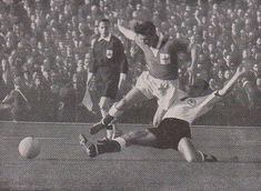 W. Germany 2 N. Ireland 2 in 1958 in Malmo. Jimmy Mcllroy is dispossessed of the ball in Group 1 at the World Cup Finals.