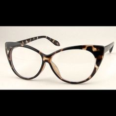 "LEOPARD VINTAGE LOOK CAT EYE FRAME GLASSES. *NWT* LEOPARD VINTAGE LOOK CAT EYE FRAME GLASSES. *NWT* Shown here in TOP TRENDING Leopard Print. GET THE RUNWAY LOOK FOR LESS!!! Red And Glossy Black also available . Non - prescription. Light weight. The perfect ""accessory"" to spice up your everyday look!!! #SWOON ThinkVintageOnline Accessories Glasses"