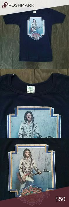 Authentic vintage Bee Gees t-shirt, size s-m. Authentic vintage Bee Gees t-shirt, size s-m. Belonged to my aunt and she gave it to me 20 years ago. Good condition, some peeling of the image. No stains or holes. Color is slightly more faded than in the pictures. Vintage Tops Tees - Short Sleeve