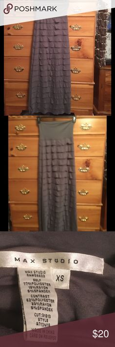 Strapless gray Sundress This is such a cool gray sundress. Strapless layered sundress. Size XS. II just love the ruffled look all Down and around the dress .Polyester rayon Spandex blend, makes it extra soft and easy to wear. Also packs well. Size XS Max Studio Dresses Strapless