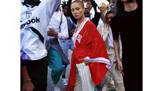 "Adwoa Aboah in Hillier Bartley - Only an English girl (or girls, in the case of Hillier Bartley) would take football and think ""silk kimono."" Adwoa, also British, approves. Note the mismatched shoes. Very Spring 2016!"