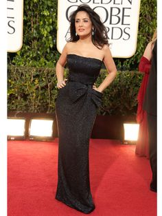 Salma Hayek in a midnight blue, body-hugging Gucci Premiere gown on the Golden Globes Red Carpet.